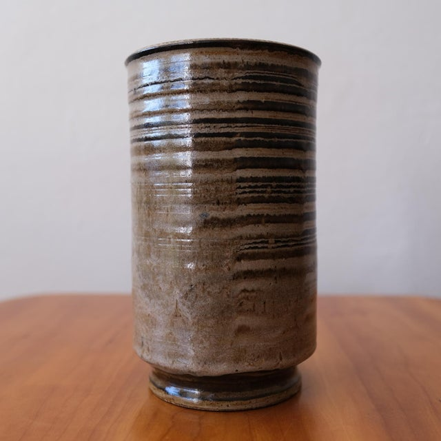 Ceramic vase by California artist, Ward Youry. Well thrown form with a nice foot. There is a striking horizontal glaze...
