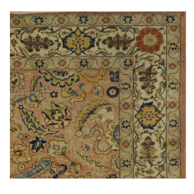 This beautiful rug is hand made, made in Iran, Tabriz region. It features a pattern in a vibrant combination of pink,...