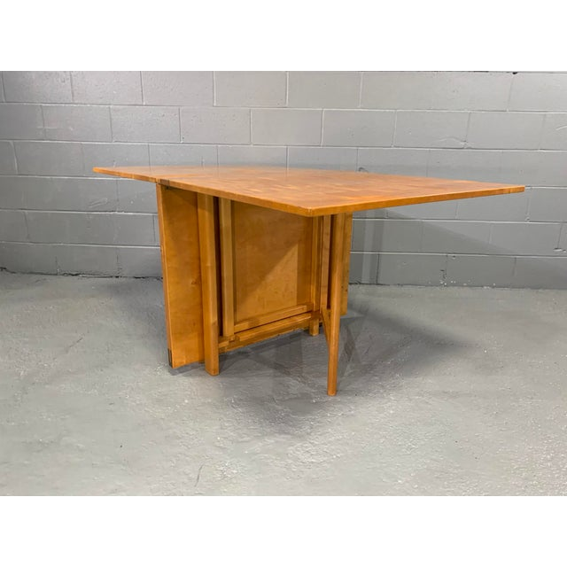 Maria Dining Table in Flame Birch by Bruno Mathsson for Karl Mathsson. Designed in 1936, this table expands from the...