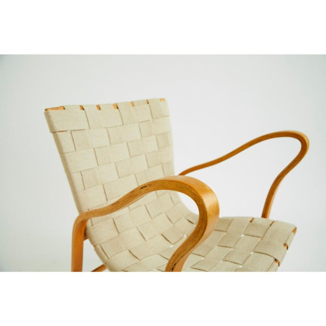Torparen easy chair by Gustav Axel Berg from the 1940's. Beautiful curvy shapes with age appropriate wear and patina....