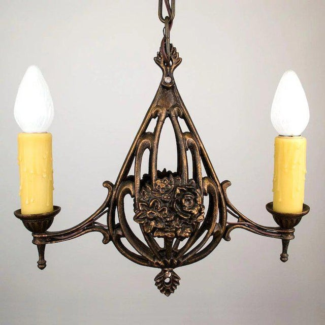 This great two light 1920's American pendant features an open work basket center with floral bouquet. It has been rewired...