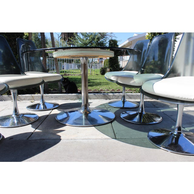Stunning 1970s Chromcraft Space Age Dining Room Set. Has big oval table with 6 swiveling tulip chairs on chrome base with...