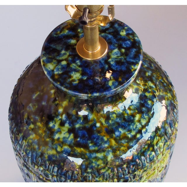 Each of super good quality and great scale, jar-form lamp with textured surface decorated with a luscious drip glaze...