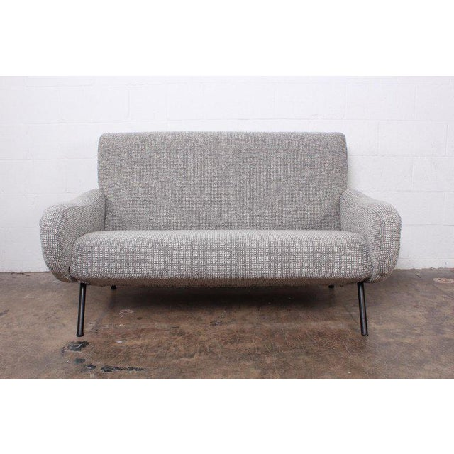 """A """"Lady"""" sofa designed by Marco Zanuso for Arflex upholstered in Maharam pebble wool."""