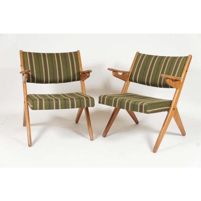 Sleek pair of Scandinavian easy lounge chairs reminiscent of Folke Ohlsson scissor chairs and Hans Wegner sawbuck chairs....
