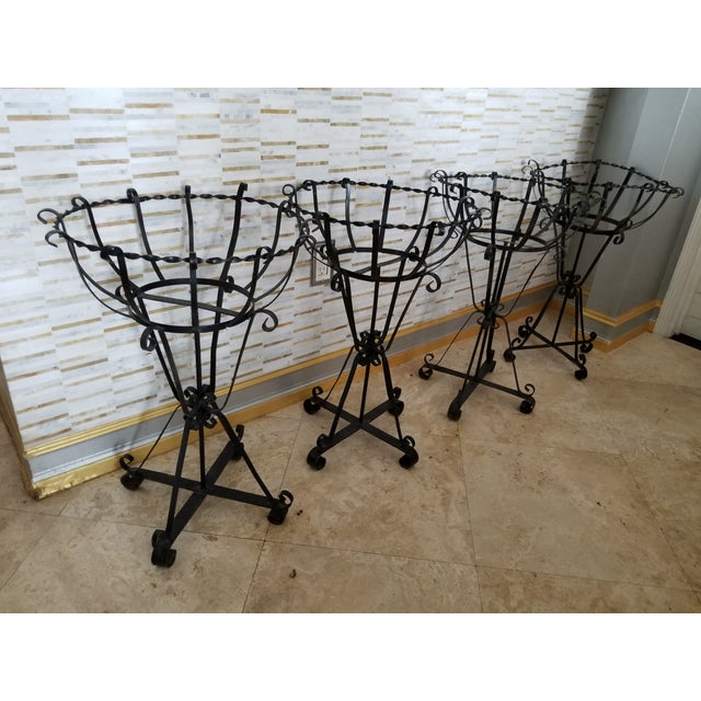 Wonderful set of 4 wrought iron vintage plant holders. THERE ARE GRAY LINER PLANTERS FOR EACH INCLUDED not yet pictured....