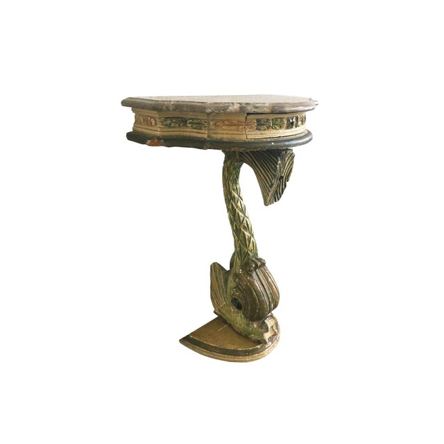 A charming demi-lune table, circa early 20th Century. Comprised of a wooden base shaped into the form of a fish. The...