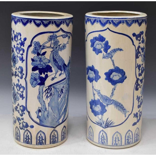 Lovely Chinese blue and white porcelain hat stand for the late 20th c. Each stand/vase features a cylindrical body...