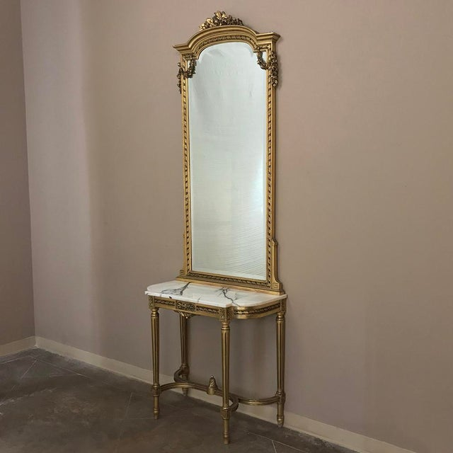 19th Century French Louis XVI Marble Top Gilt-wood Console with Mirror is the perfect way to create a stunning entryway,...