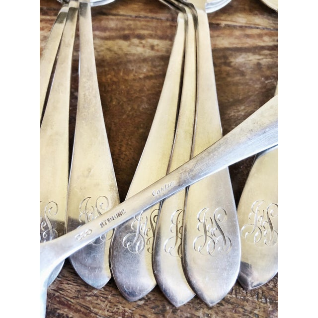 A beautiful set of 12 vintage circa 1950–60s solid sterling silver cream soup spoons, made by Cartier! In excellent...