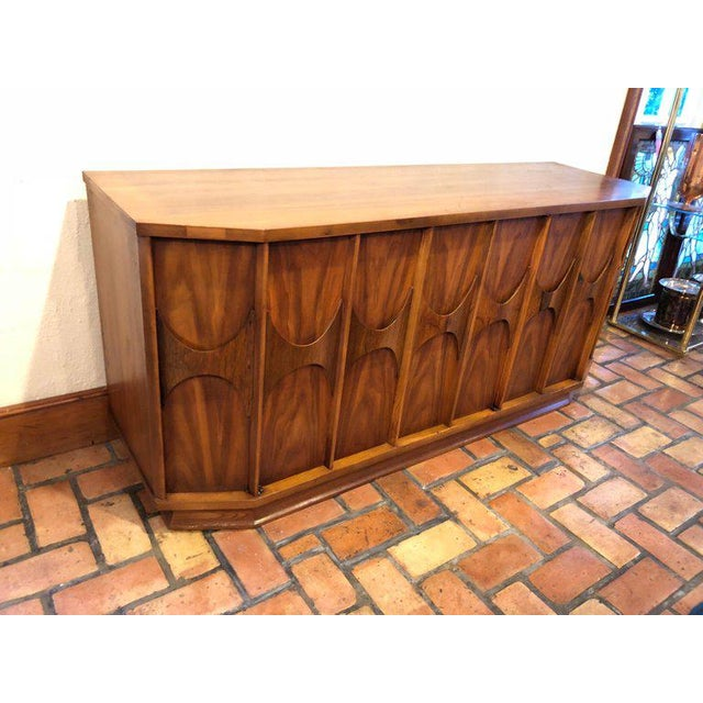 Mid-Century Modern Brutalist credenza in the style of Broyhill Brasilia by Kent Coffey. Great foyer or entryway piece. Or...