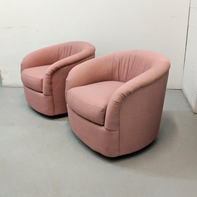Available for purchase, a pair of modern barrel-shaped lounge chairs in original dark pink fabric. These chairs have clean...