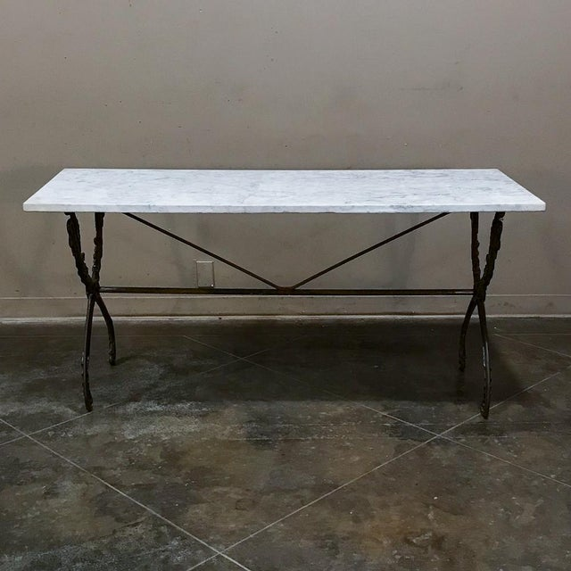 19th Century Wrought Iron Marble Top Confectioner's Table makes a great choice as a sofa table, a spot in the hall, or any...