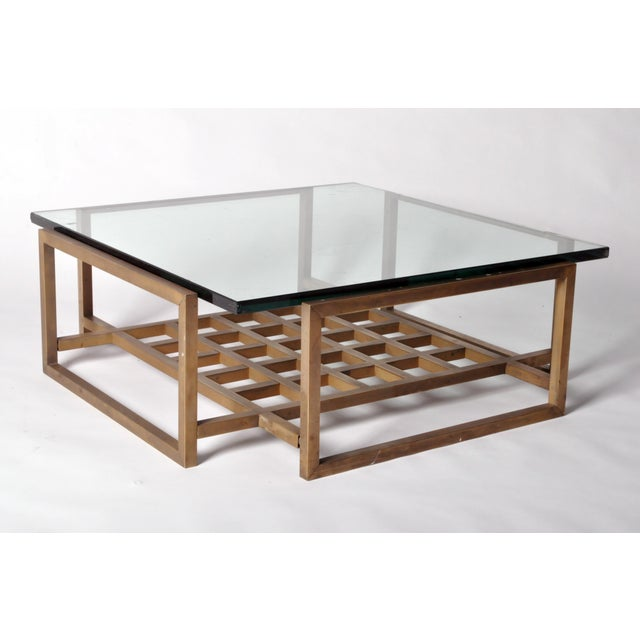This Mid-Century Modern low table is a handsome convergence of both materials and shapes. Pulling from the Hollywood...