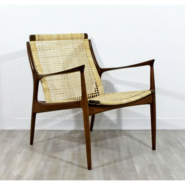For your consideration is a marvelous, Danish cane armchair, by Kofod Larsen, circa the 1960s. In excellent condition. The...