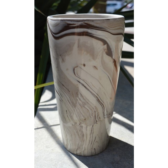 We love a good marbleized look! This vase is sturdy, with ceramic walls that are on the thicker width. Fits a modern,...