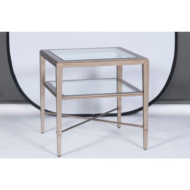 An elegant side table with neoclassical accents and two convenient glass shelves. Promiseland Designed by Michael Weiss...