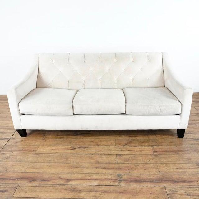 Bearing three cushions. Raised on wood legs. Dimensions (in): 72.0 W x 32.0 D x 32.0 H.