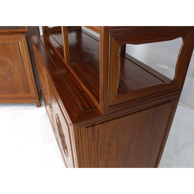 Pair of decorative solid teak carved étagères bookcases shelves with bottom cabinets. Asian inspired. Solid brass pulls.