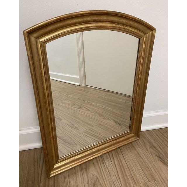 This small 19th Century Louis Philippe mirror features a simple giltwood frame. The arched top is somewhat different than...