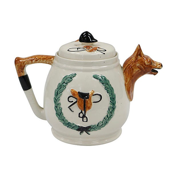Hand-Painted English fox hunting scene tea pot. Maker's mark on underside. Light wear to paint, minor glaze flaws.