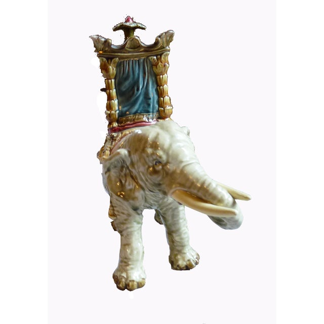 Bohemian pottery Japanesque faience elephant inset with ansonia mantle clock. Circa 1885. the rectangular clock placed...