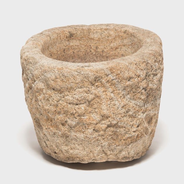 This round stone vessel was hand-carved from a single block of granite by a Qing-dynasty artisan in China's Shanxi...