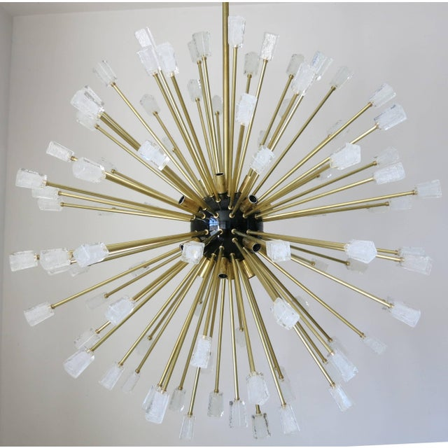 Modern Italian sputnik chandelier composed of 96 unique clear Murano glass cubes blown in Pulegoso technique to provide an...