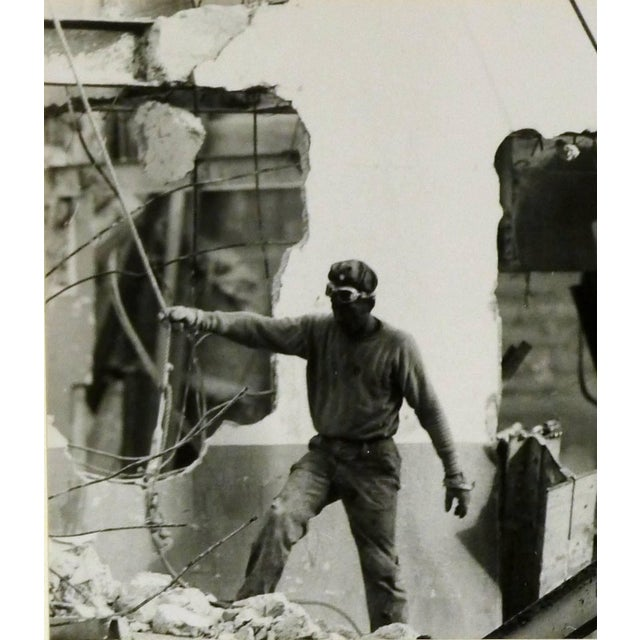 Original pencil signed silver gelatin photograph of a workman among building debris by Shirley Carter Burden, 1953. Signed...