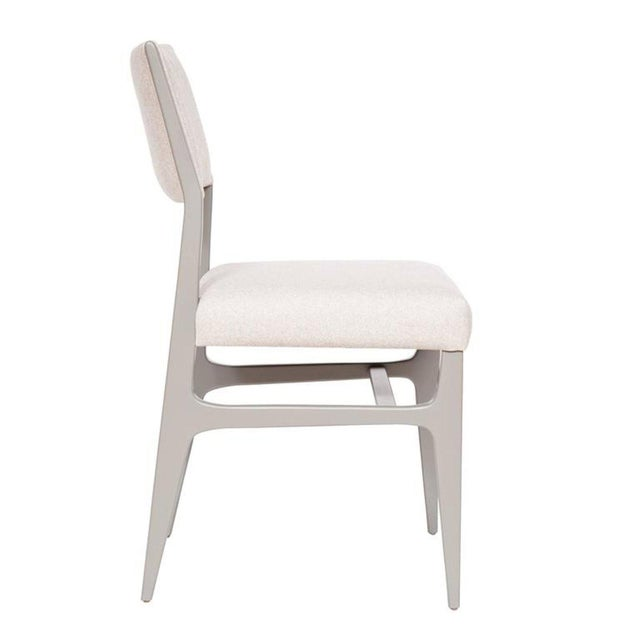 """Lacquered dining chair. Measures: Seat height 19"""", seat depth 17"""". COM requirements: 1.5 yards 5% up-charge for..."""
