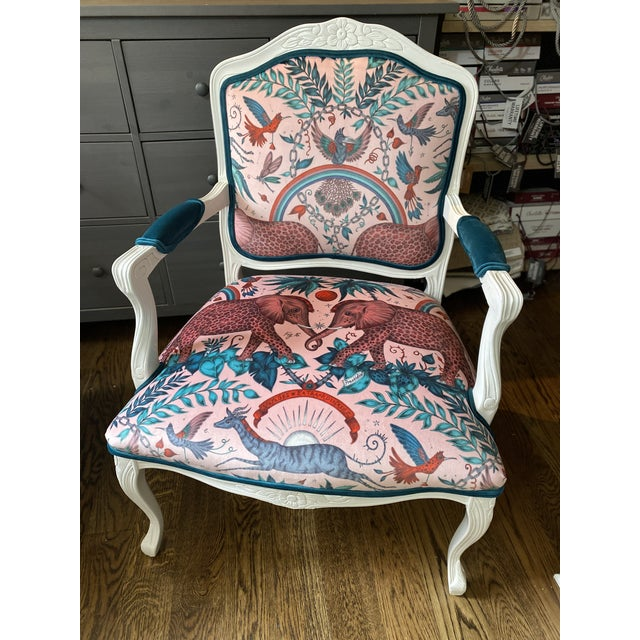 A unique pair of custom upholstered and painted accent chairs. Chairs are painted and finished white and upholstered in a...