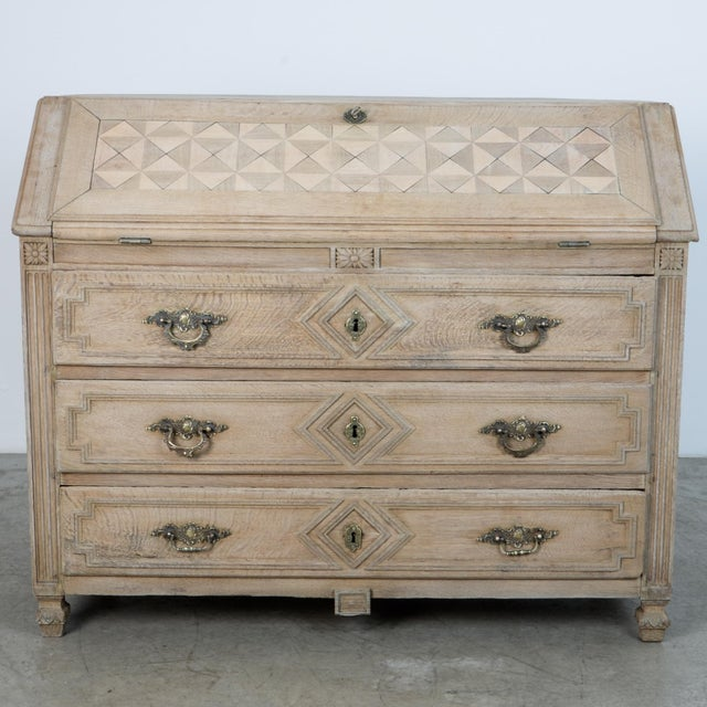 From France, circa 1860, this piece follows the tradition of French Provincial furniture workshops. With a characteristic...