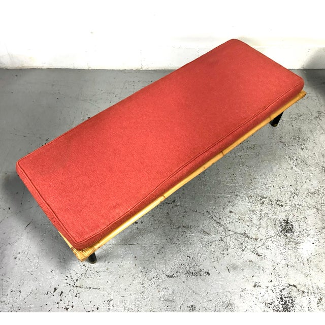 A rare, possibly custom, pair of Ficks Reed upholstered benches with original coral fabric cushions. In the style of other...