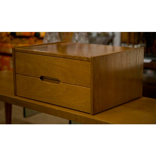 A two drawer letterbox organizer in oak by Aksel Kjersgaard. Another example available in teak. Danish, circa 1950. The...
