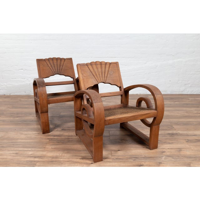 Early 20th Century Teak Wood Country Chairs From Madura With Rattan Seats and Looping Arms - a Pair For Sale - Image 5 of 13
