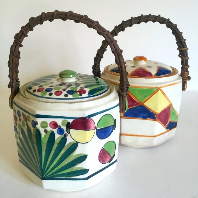 This set of two rare vintage 1930's Art Deco Japan hand painted porcelain handled ceramic biscuit barrel jars is an...