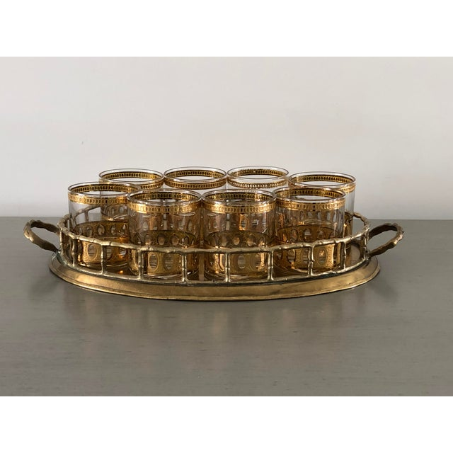 A set of 8 vintage Old Fashioned Culver cocktail glasses in the antigua pattern. These glasses are plated in 22k gold and...
