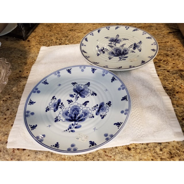 Last call. No further markdowns. No bids accepted. Very pretty blue on blue, signed Delft plates. Recently removed from...