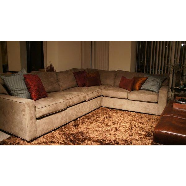 This sectional is amazingly comfortable and a great anchor piece for any living room. The suede cover is extremely warm in...