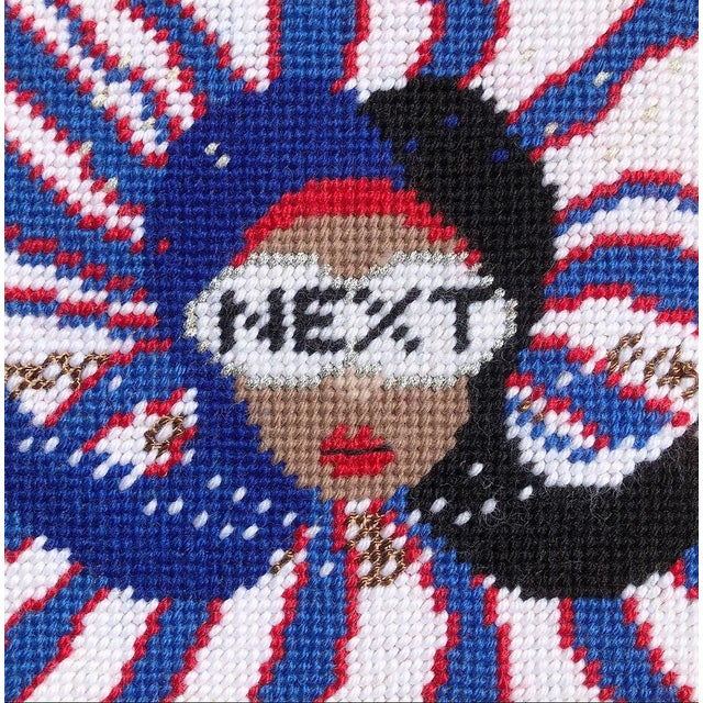 NEXT is not political. Not at all. NEXT is one in a series of needlepoint objets d'art - our unique, one of a kind pillow...