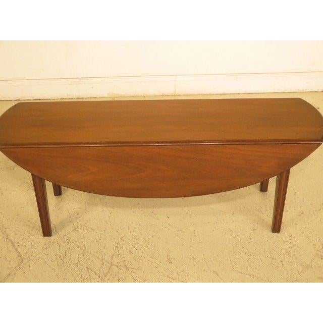 Kittinger drop leaf mahogany coffee table. Features high quality construction., scuffs & indentation from age as shown.