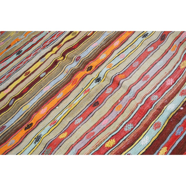 Vintage Turkish Anatolian hand woven kilim with natural colors and fine weave.