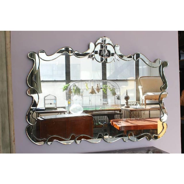 American 1950's Venetian style wall mirror. Mirror is composed of one large center piece of mirror with individual mirror...