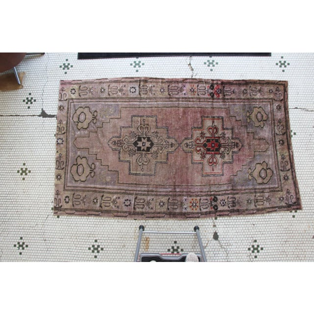 Vintage hand-knotted flat-woven Turkish Anadol rug with medallions and border design. Piece shows age wear.