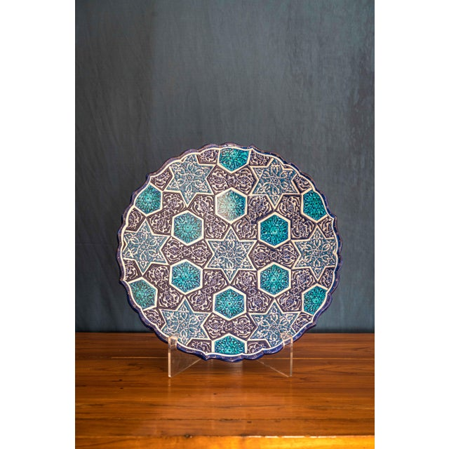 With a beautiful arabesque design hand-painted in blues and white, this gorgeous, large-size ceramic dinner plate...
