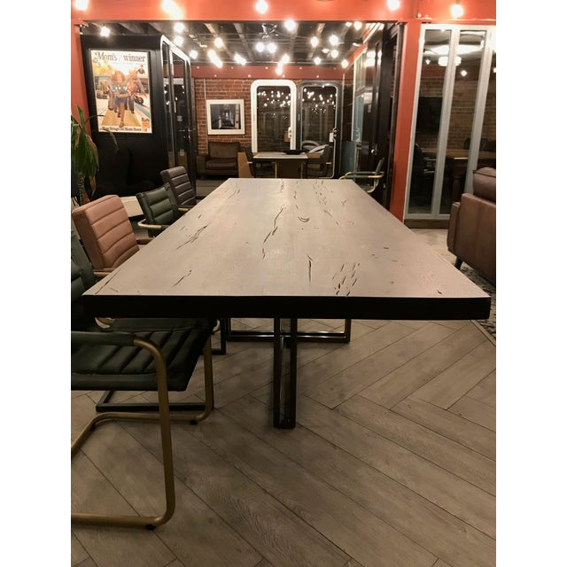Large rustic oak dining table with a contemporary painted brass base. A beautiful Romanian eye-catching piece for a...