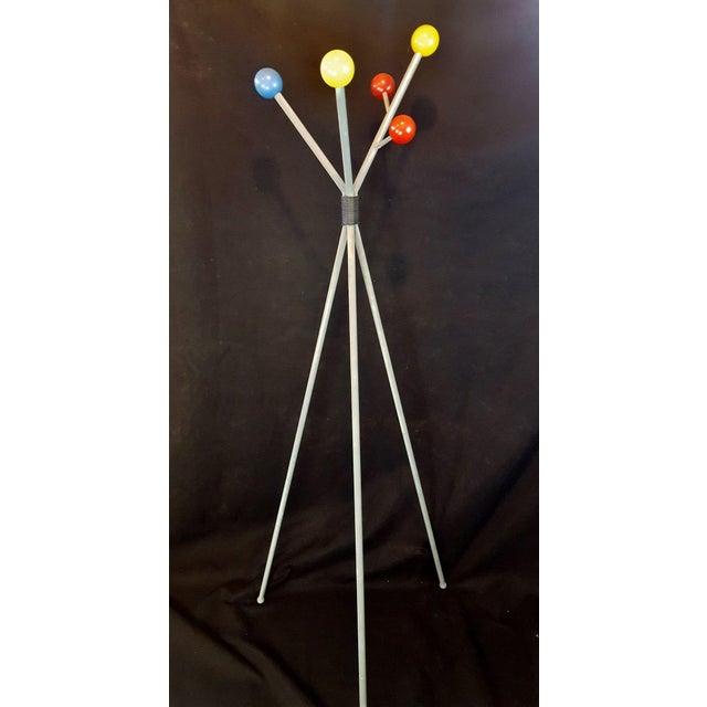 This is a cool sputnik coat rack featuring primary colored wooden spheres in the atomic style of George Nelson. There are...