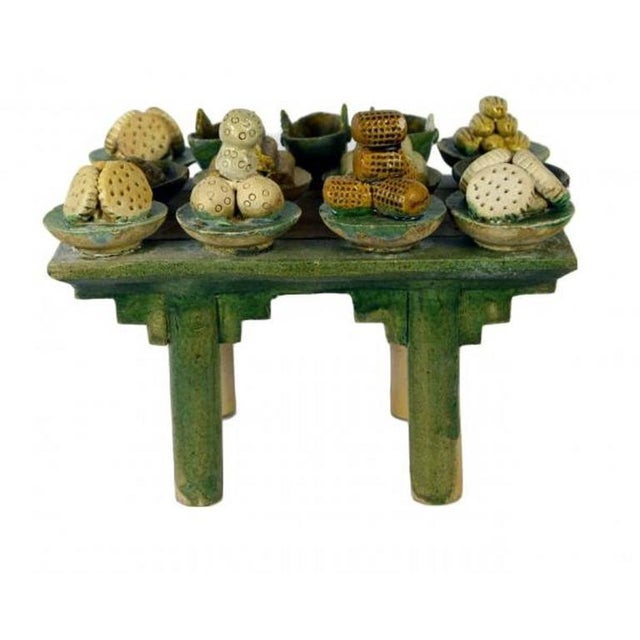 A Ming dynasty terracotta funeral table from 15th-16th century China. This Chinese funeral table was made with terracotta...