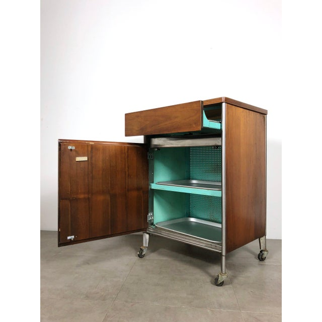 Industrial 1950s Raymond Loewy Hill-Rom Walnut & White Laminate Rolling Cabinet For Sale - Image 3 of 10