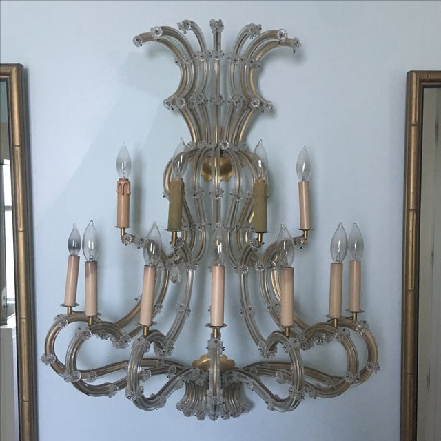 Vintage 11 light large crystal sconce. This light is in excellent shape but listed as good because it is missing all of...